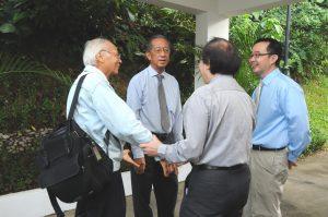 Sharing a warm moment: (From left) Former Scientific Advisory Board member LUI Pao Chuen, Bernard TAN, Louis CHEN (back facing camera) and Deputy Director TAN Ser Peow