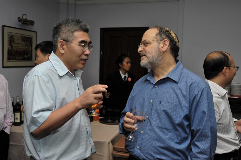 At the reception: (From left) ZHANG Louxin, David SROLOVITZ