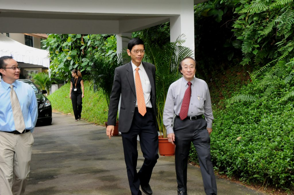 Striding towards the future: President TAN Chorh Chuan flanked by Director and Deputy Director